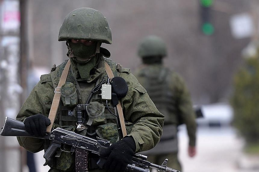 Russian soldiers patrol outside the navy headquarters in Simferopol on March 18, 2014. -- PHOTO: AFP