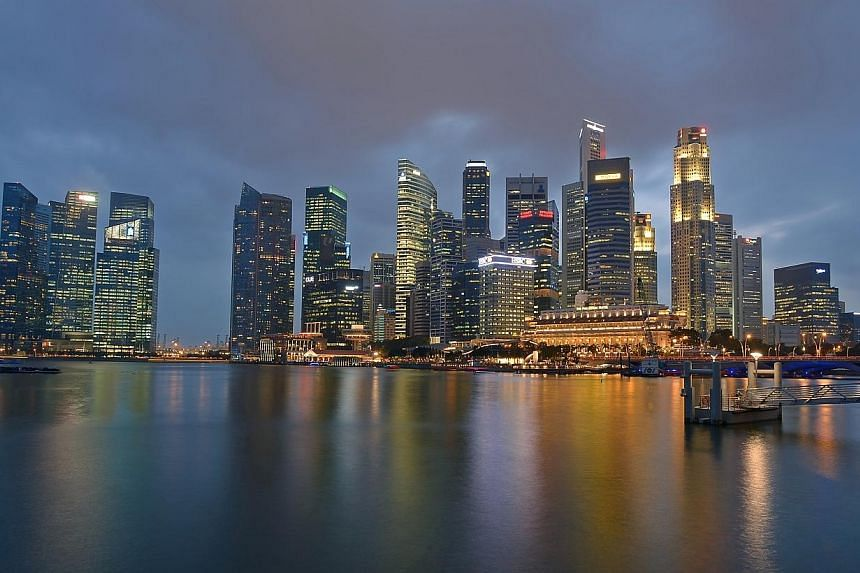 The Singapore Central Business District (CBD) skyline in the evening on Jan 27, 2014. -- ST FILE PHOTO: DESMOND WEE