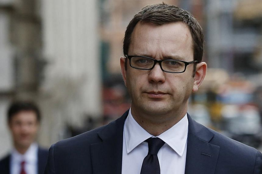 Former editor of the News of the World Andy Coulson leaves the Old Bailey courthouse in London on March 18 , 2014. -- PHOTO: REUTERS
