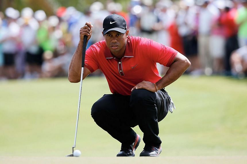 Tiger Woods had hoped to play in the US$6.2 million (S$7.8 million) tournament but said continued back spasms forced him to withdraw on Tuesday. -- FILE PHOTO: AFP