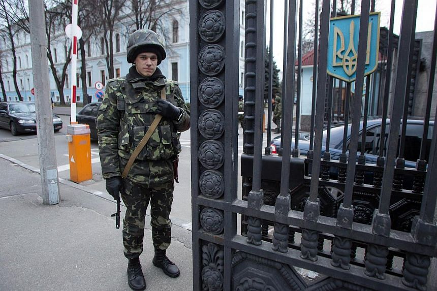 A soldier stands guard at the Ukrainian Defence Ministry in Kiev on March 18, 2014. -- PHOTO: AFP