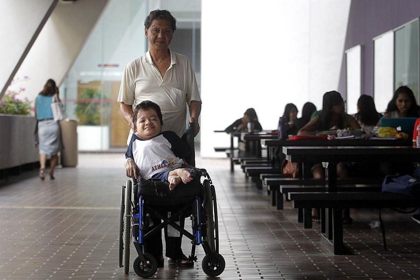 NTU undergrad Daniel Seah with his dad, Mr Seah Hong Tiang, who accompanies him to school daily (left) and carries him to seats in lecture theatres (right).