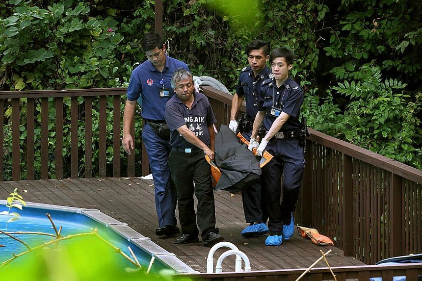 The body of Ms Nancy Gan, 69, being taken away from the swimming pool of her bungalow in Bukit Timah yesterday. A 23-year-old Indonesian maid has been arrested. -- ST PHOTO: LAU FOOK KONG