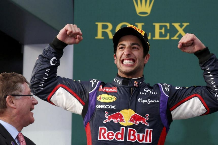 Red Bull Formula One driver Daniel Ricciardo of Australia (R) celebrates finishing second in the Australian F1 Grand Prix at the Albert Park circuit in Melbourne March 16, 2014. Formula One champions Red Bull have formally appealed against the disqua