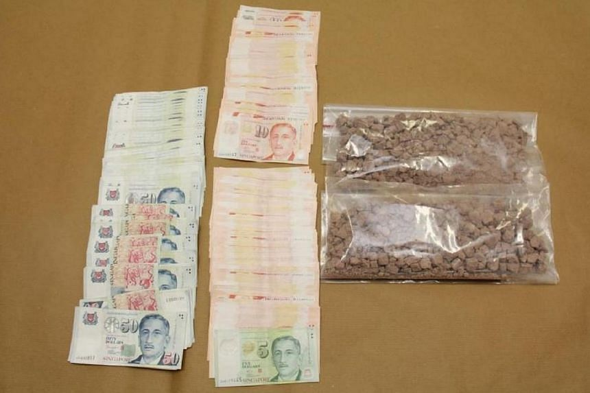 Heroin and cash seized in CNB operation on March 19, 2014. -- PHOTO: CENTRAL NARCOTICS BUREAU
