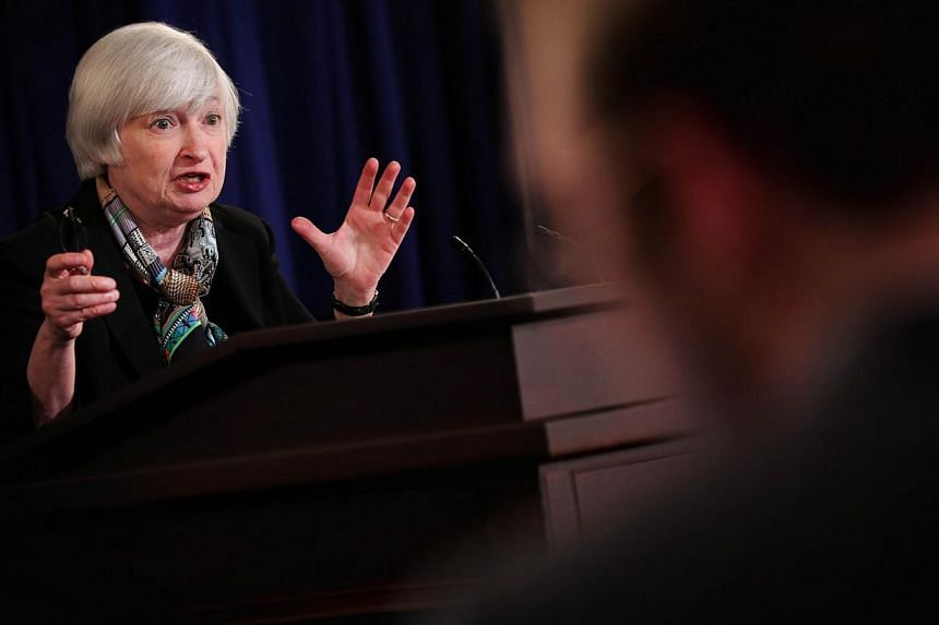 The Federal Reserve will probably end its massive bond-buying program this coming fall, and could start to raise interest rates around six months later, Fed Chair Janet Yellen said on Wednesday. -- PHOTO: AFP