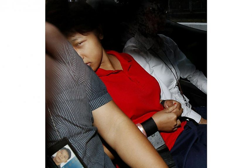 Dewi Sukowati, 23, is alleged to have caused the death of her 69-year-old employer Nancy Gan at her Victoria Park Road bungalow in Bukit Timah between 7.30am and 8.46am on Wednesday. -- ST PHOTO: WONG KWAI CHOW