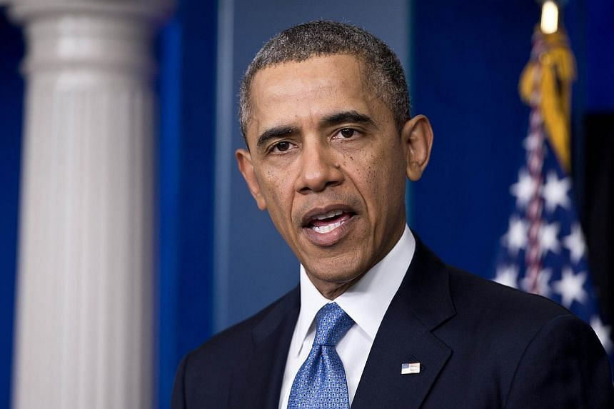 """US President Barack Obama makes a statement about the situation in Ukraine in the White House briefing room in Washington,DC on March 17, 2014.Obama on Thursday, March 20, 2014, called on the """"entire"""" government in Teheran to seize on nuclear t"""