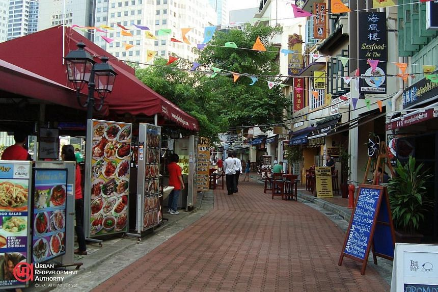 Menu boards and overhead wires along Boat Quay's public walkway. -- PHOTO:URBAN REDEVELOPMENT AUTHORITY
