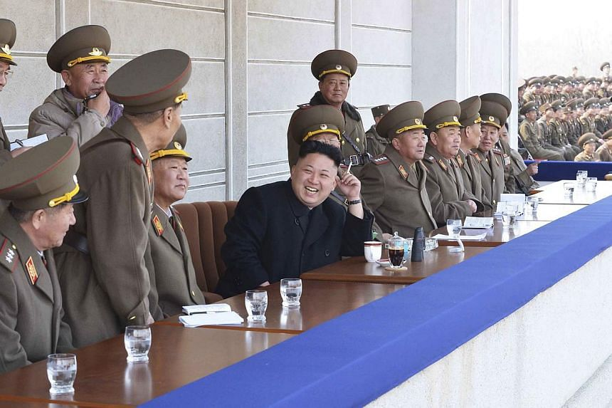 North Korean leader Kim Jong Un attends a firing competition among teachers of Kim Jong Suk Naval University and Kim Chaek Air Force University. The country said on Thursday its new Parliament would meet for the first time in April. -- PHOTO: REUTERS