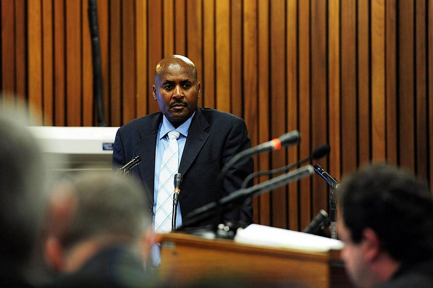 Ballistics expert Christiaan Mangena testifying during the trial of South African Paralympic athlete Oscar Pistorius for the murder of his girlfriend Reeva Steenkamp at the North Gauteng High Court in Pretoria on March 19, 2014. -- PHOTO: AFP