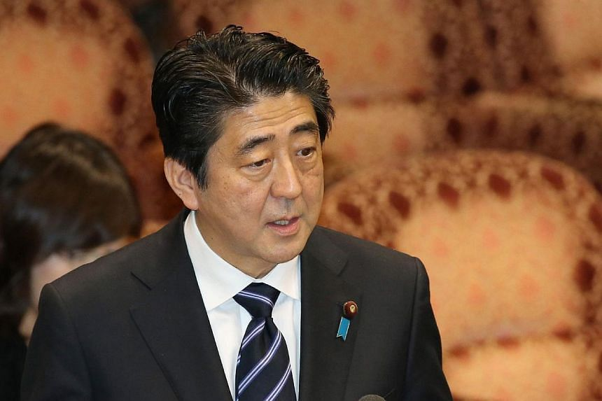 Japanese Prime Minister Shinzo Abe answers a question at a Lower House budget committee session at the National Diet in Tokyo on March 14, 2014. Japanese Prime Minister Shinzo Abe said on Thursday, March 20, 2014, he hopes to resume formal talks