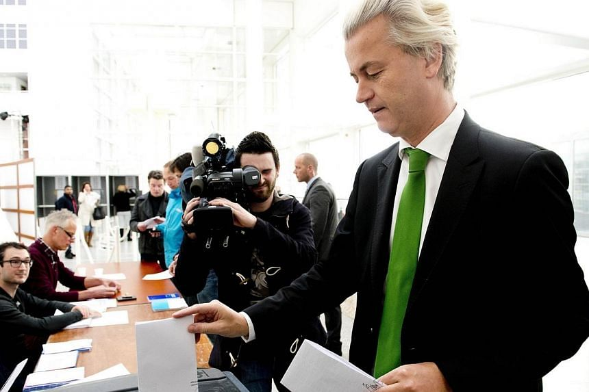 Dutch PVV (anti-muslim populist party) leader Geert Wilders casts his ballot for the Dutch municipal council elections at a polling station in The Hague on March 19, 2014. The largest Moroccan grouping in the Netherlands said on Thursday, March