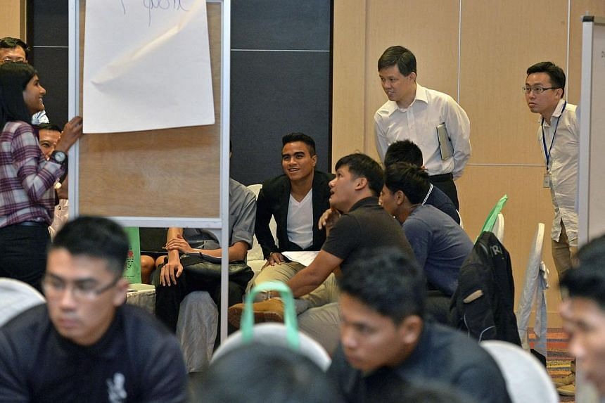 Second Minister for Defence Chan Chun Sing (standing, second from right) listening in on a lively session. Participants included SAF and Home Team NS commanders, civil servants, researchers and members of the Committee to Strengthen National Service.