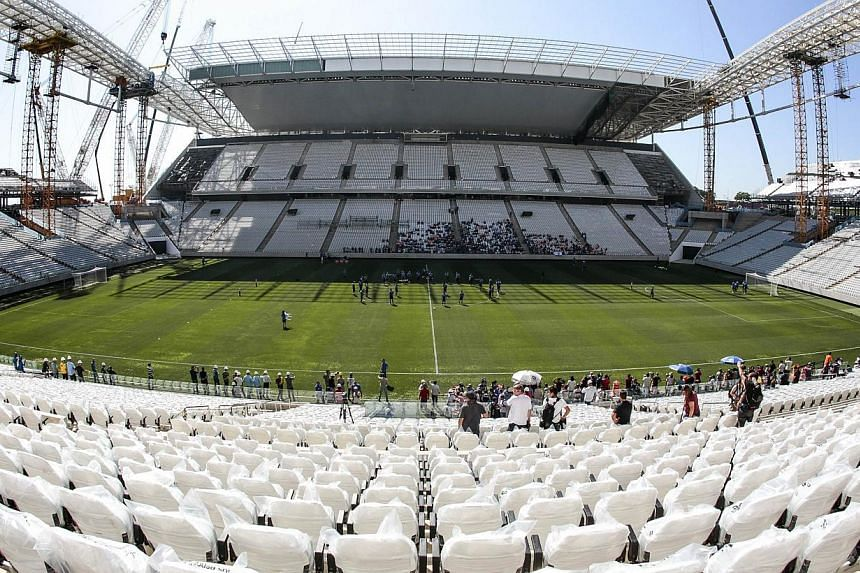 The first official practice carried out at the Arena de Sao Paulo (Itaquerao) stadium conducted by the Corinthians team on March 15, 2014 in Sao Paulo, Brazil. -- FILE PHOTO: AFP