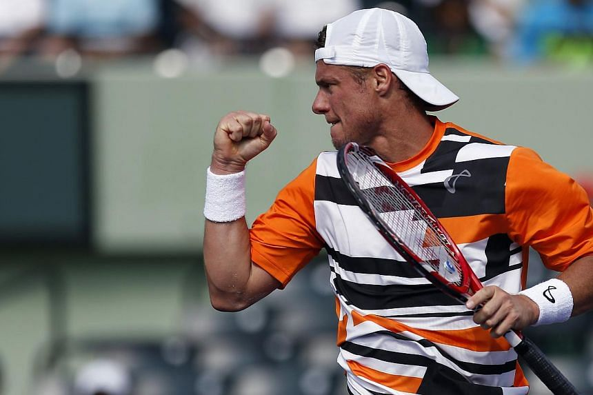 Lleyton Hewitt reacts during his match against Robin Haase (not pictured) on day four of the Sony Open at Crandon Tennis Center on March 20, 2014. -- PHOTO: USA TODAY SPORTS/GEOFF BURKE