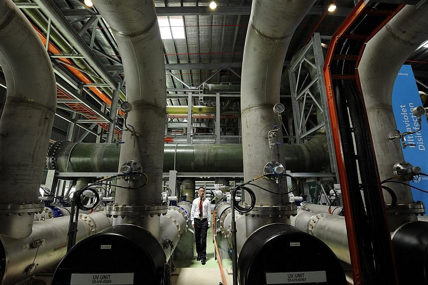 A Sembcorp Industries Ltd engineer inspects the ultraviolet disinfection pipes used in the treatment of recycled water, in the Sembcorp Newater plant in Singapore on Monday, May 3, 2010. Newater, has won a best-practices award from the United Nations
