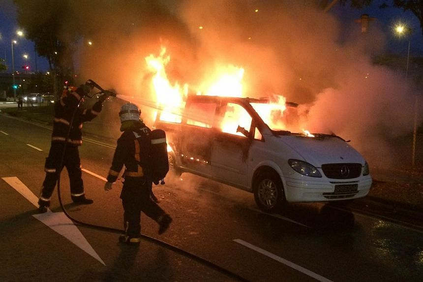 A ComfortDelGro MaxiCab just one month away from being scrapped burst into flames on Lorong Chuan Friday night.-- ST PHOTO:STEPHANIE YEOW