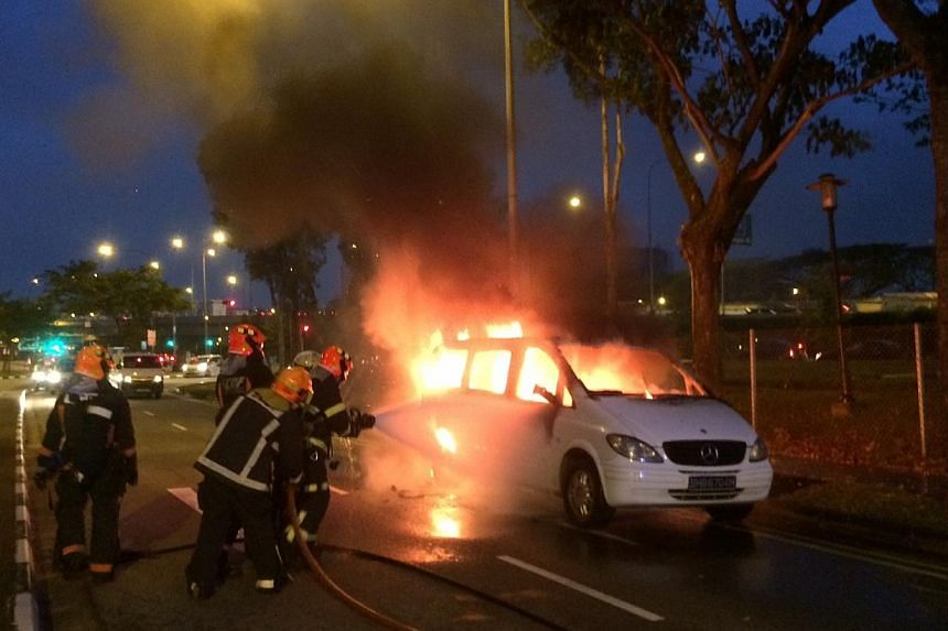 A ComfortDelGro MaxiCab just one month away from being scrapped burst into flames on Lorong Chuan Friday night. -- ST PHOTO: STEPHANIE YEOW