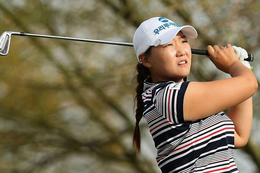 Mirim Lee of South Korea hits a tee shot on the fourth hole during the first round of the JTBC LPGA Founders Cup at Wildfire Golf Club on March 20, 2014 in Phoenix, Arizona. -- PHOTO: AFP