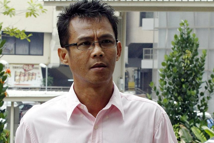 Juraimi Kamaludin, who wasconvicted of spitting at two women at Woodlands bus interchange last October, was jailed for five weeks and fined $800 on March 21, 2014. --ST PHOTO: WONG KWAI CHOW