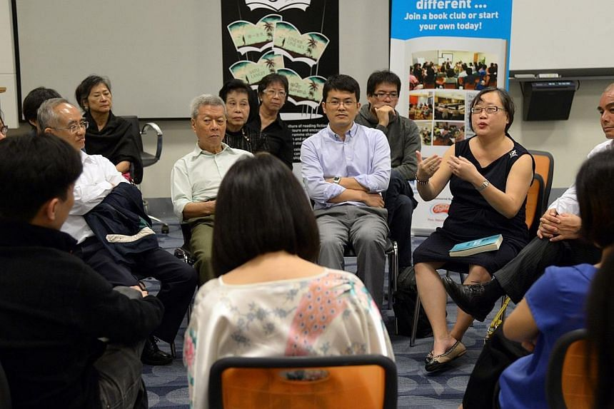 Senior writer Cheong Suk-Wai (right, in black) moderating The Straits Times' second Big Read Meet at the National Library Board headquarters on Nov 27, 2013. The StraitsTimes' first non-fiction book club, The Big Read Meet, will be back with a