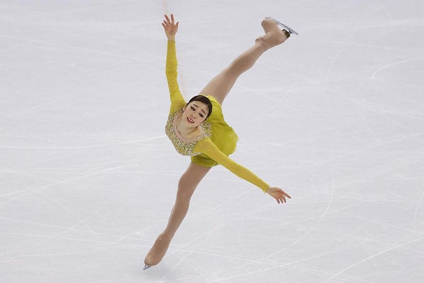 Korea's Yuna Kim competes during the Figure Skating Women's Short Program at the Sochi 2014 Winter Olympics, Feb 19, 2014.South Korea's Olympic body said on Friday, March 21, 2014, it would file a complaint with the international governing body