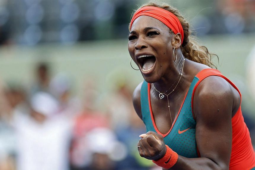 Serena Williams reacts after winning the first set against Yaroslava Shvedova (not pictured) on day four of the Sony Open at Crandon Tennis Center.-- PHOTO:GEOFF BURKE-USA TODAY SPORTS