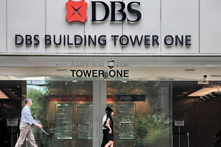 People are seen walking in front of the DBS Building Tower One in Singapore in this picture taken on April 2, 2012. DBS Bank is aiming to expand its small and medium-sized enterprise (SME) banking business beyond Singapore and Hong Kong thi