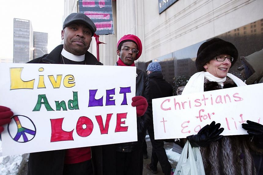 Pro-traditional marriage supporters protest next to gay marriage supporters in front of the US federal courthouse March 3 in Detroit, Michigan.A US federal judge struck down a gay marriage ban in the mid-western state of Michigan and found ther
