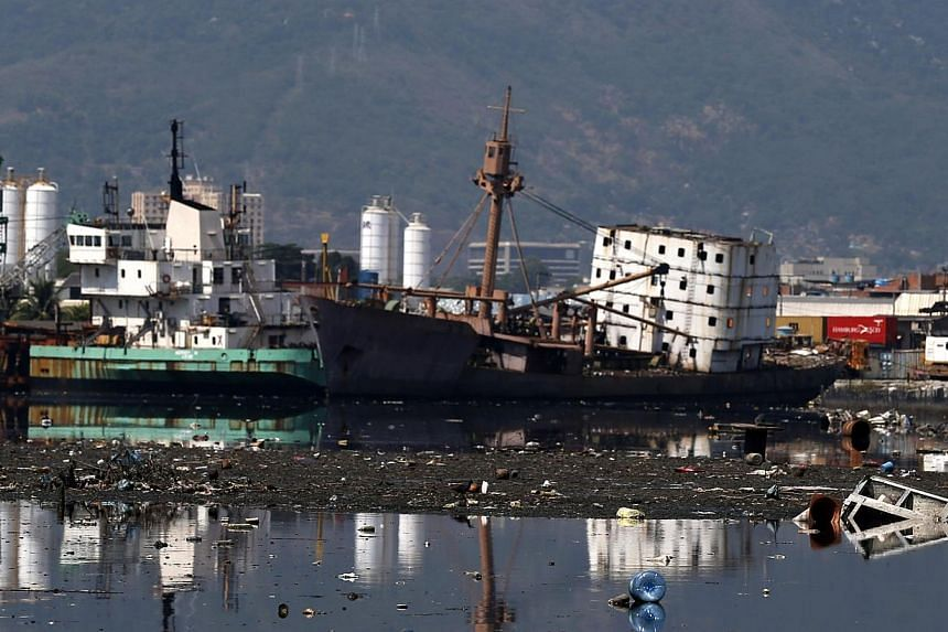 Old ships are seen at Guanabara Bay in Rio de Janeiro March 12.Waters polluted by sewage off the coast of Rio remain a concern for organisers of the 2016 Olympics, but the International Olympic Committee insisted on Friday that the sea will be