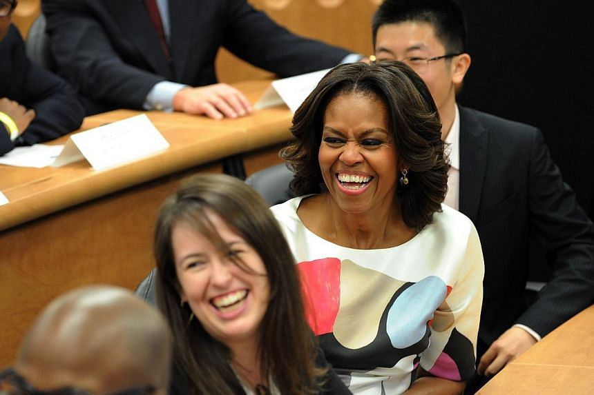 US first lady Michelle Obama participates in a discussion with students at the Stanford Center at Peking University in Beijing on March 22, 2014. -- PHOTO: AFP