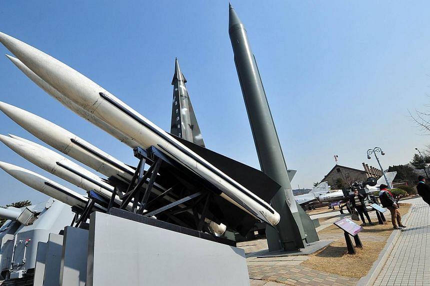 Visitors walk past replicas of a North Korean Scud-B missile (right) and South Korean Hawk surface-to-air missiles (left) at the Korean War Memorial in Seoul on March 3. North Korea test-fired 30 short-range missiles into the sea on Saturday, th