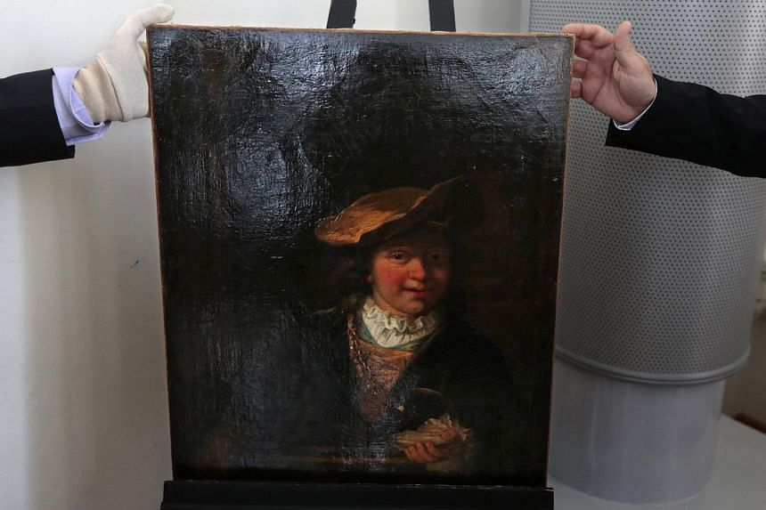 The painting L'enfant a la bulle de savon, 1630 (Child with a Soap Bubble) attributed to painter Rembrandt (1606-1669)was stolen from a French museum in 1999 and recovered this week. -- PHOTO: REUTERS