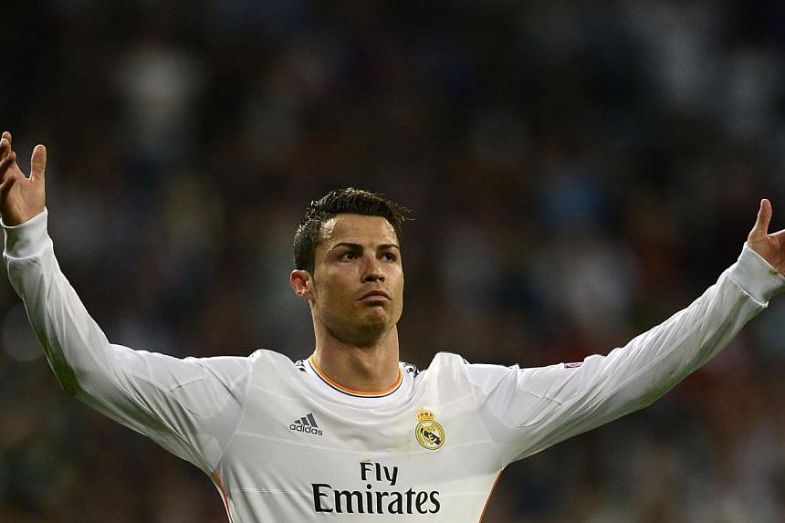 Real Madrid's Portuguese forward Cristiano Ronaldo at a UEFA Champions League match in Madrid on March 18.Four executive jets carrying Ronaldo's family and entourage will follow the Portuguese star around at the World Cup. -- PHOTO: AFP