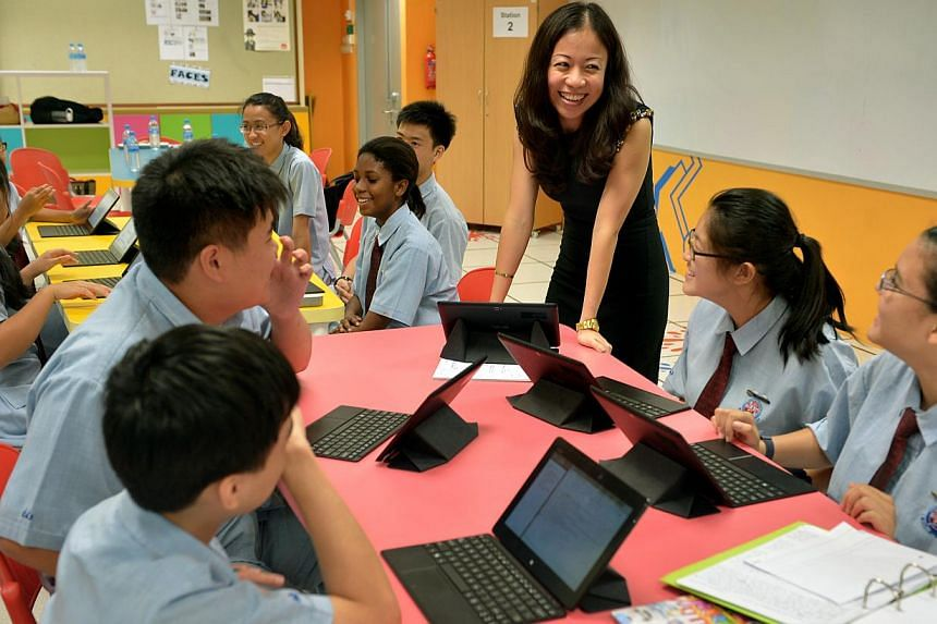 Madam Chen Si Yun, a science teacher at Chestnut Drive Secondary School, giving students a lesson using their tablets in the iSpark room, a room for collaborative learning. Madam Chen also used the Kinect by Microsoft to help students with dyslexia a