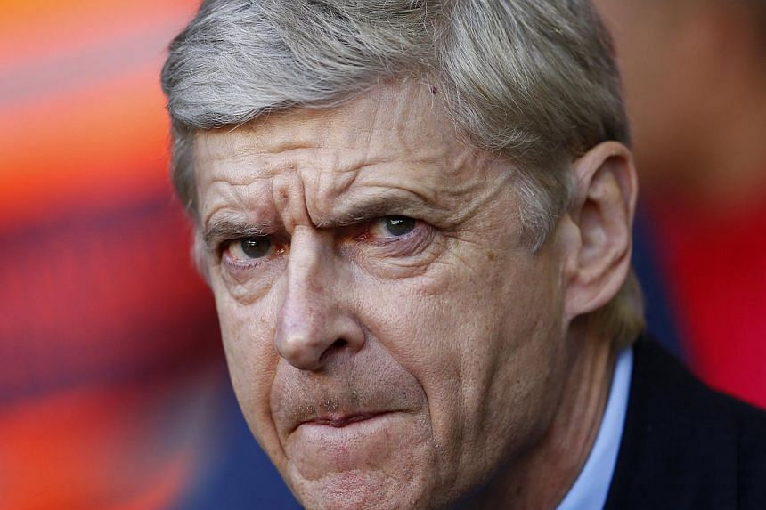 Arsenal's manager Arsene Wenger has revealed there should be no uncertainty at all over his future as he prepares to celebrate his 1,000th match in charge of Arsenal. -- PHOTO: REUTERS