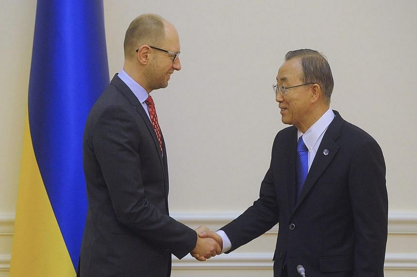 Ukrainian Prime Minister Arseny Yatseniuk (left) meets United Nations Secretary General Ban Ki Moon in Kiev, March 22, 2014.Ukraine hosts two vital allies on Saturday, March 22, 2014, amid Western efforts to cement Kiev's leaning away from Mosc