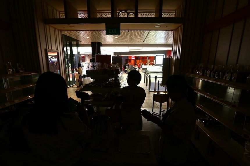 The Jem shopping mall in Jurong East was hit by a power cut on Friday, which lasted 11 hours. -- TNP PHOTO: GAVIN FOO