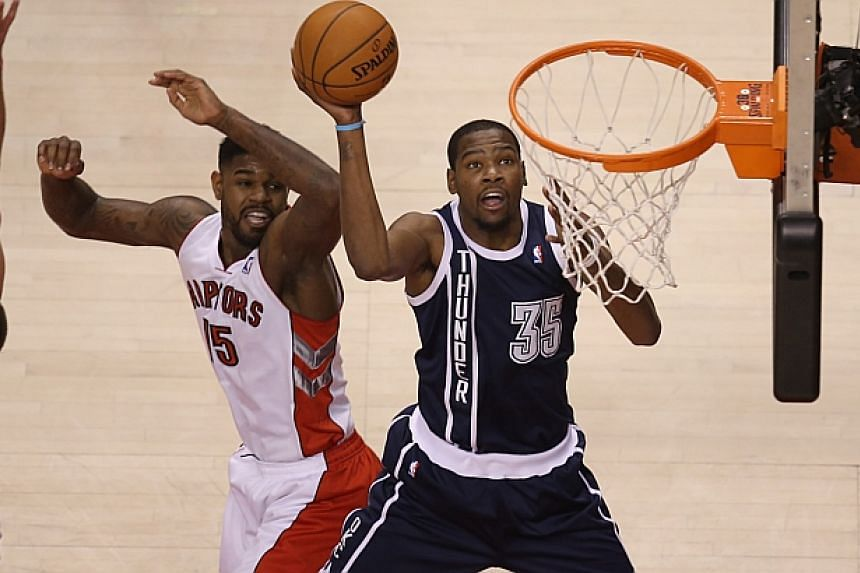 Forward Kevin Durant (right) hit a game-winning three-pointer with 1.7 seconds left to cap off a 51-point effort to lead his Oklahoma City Thunder 119-118 over the Toronto Raptors in a double-overtime National Basketball Association (NBA) game on Fri
