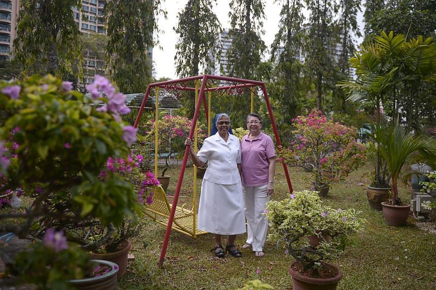 Sister Gerard Fernandez (left) and Sister Elizabeth Lim in the garden of the Marymount home of the Good Shepherd Sisters. Their Marymount Centre (below) will make way for the building of the North-South Expressway.