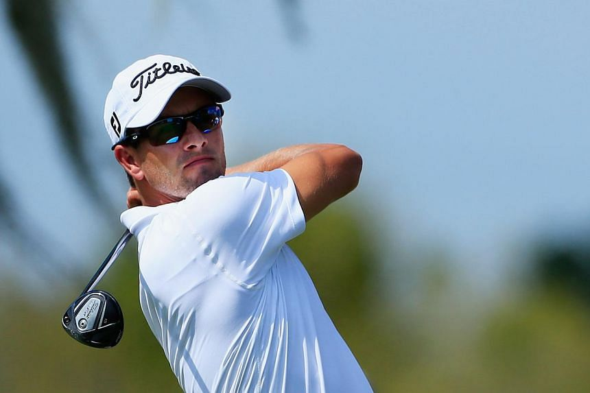 Adam Scott of Australia hits his tee shot on the eighth hole during the third round