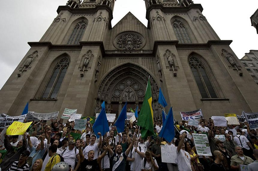 Right-wing activists take part in a march in front of Se's Cathedral in Sao Paulo downtown, as part of the celebrations for the 50th anniversary of the military coup, on March 22, 2014. -- PHOTO: AFP