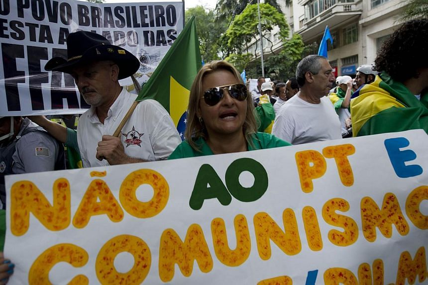 Right-wing activists take part in a march in Sao Paulo downtown, as part of the celebrations for the 50th anniversary of the military coup, on March 22, 2014. -- PHOTO: AFP