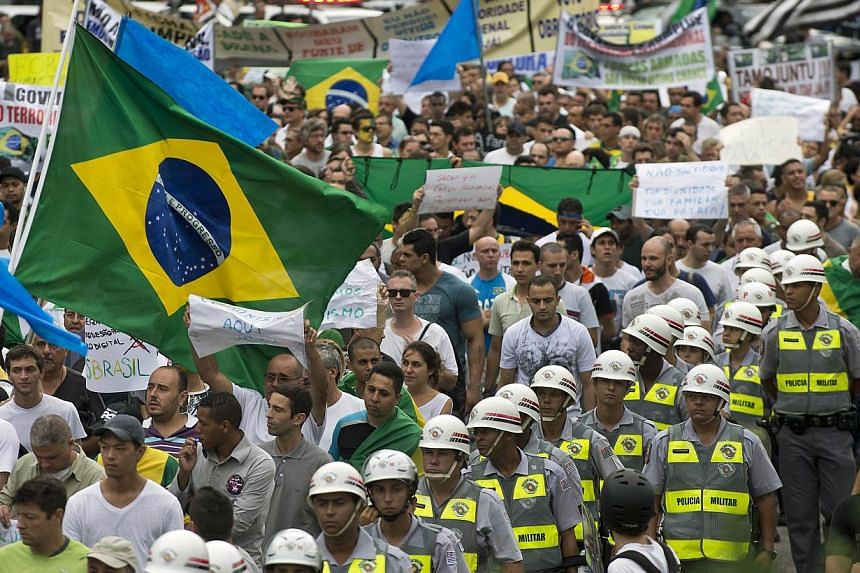 Right-wing activists take part in a march in Sao Paulo downtown, as part of the celebrations for the 50th anniversary of the military coup , on March 22, 2014. -- PHOTO: AFP