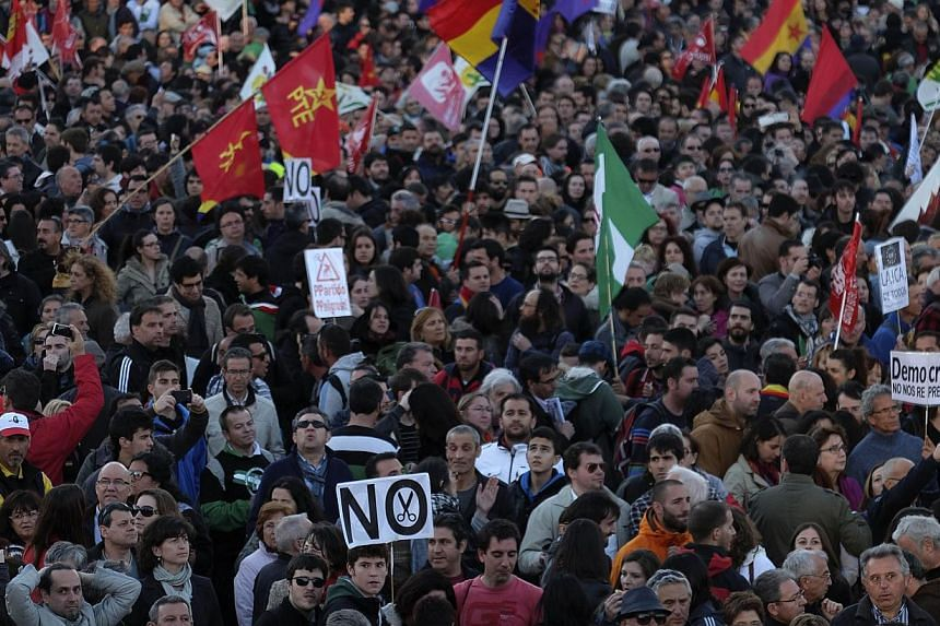 """Tens of thousands of demonstrators take part in a march dubbed """"the Marches for Dignity 22-M"""" to protest against austerity in Madrid on March 22, 2014. -- PHOTO: AFP"""