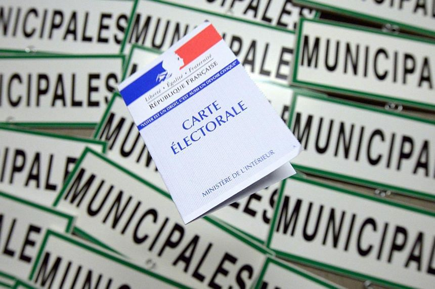 A French voting card. Polls have suggested around one in four voters are considering casting their votes for Ms Marine Le Pen's National Front. -- FILE PHOTO: AFP