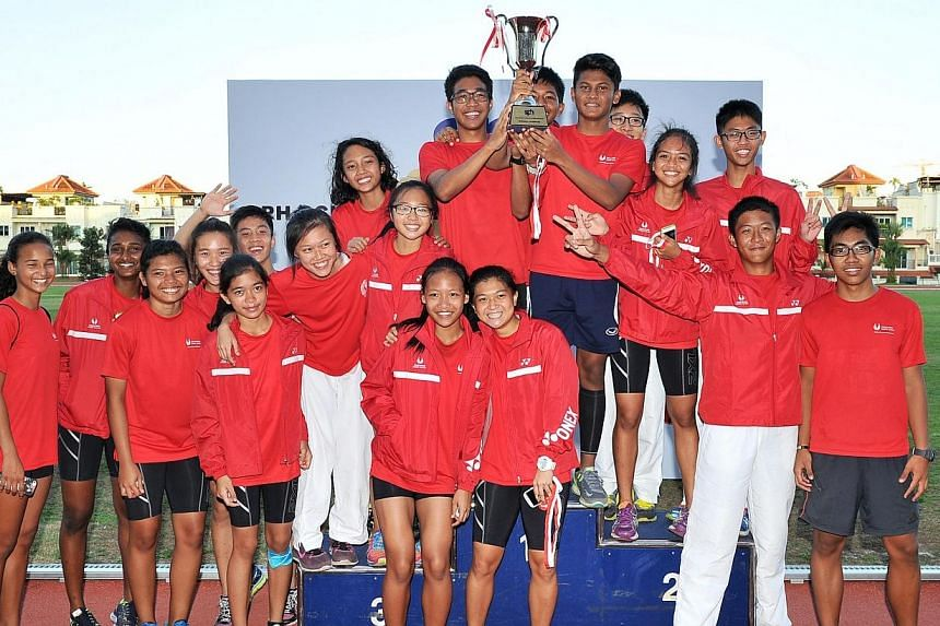 The Singapore Sports School (SSP) team were crowned overall champions of the 2014 SPH Schools Relay at Choa Chu Kang Stadium on Sunday  evening. -- ST PHOTO: LIM YAOHUI