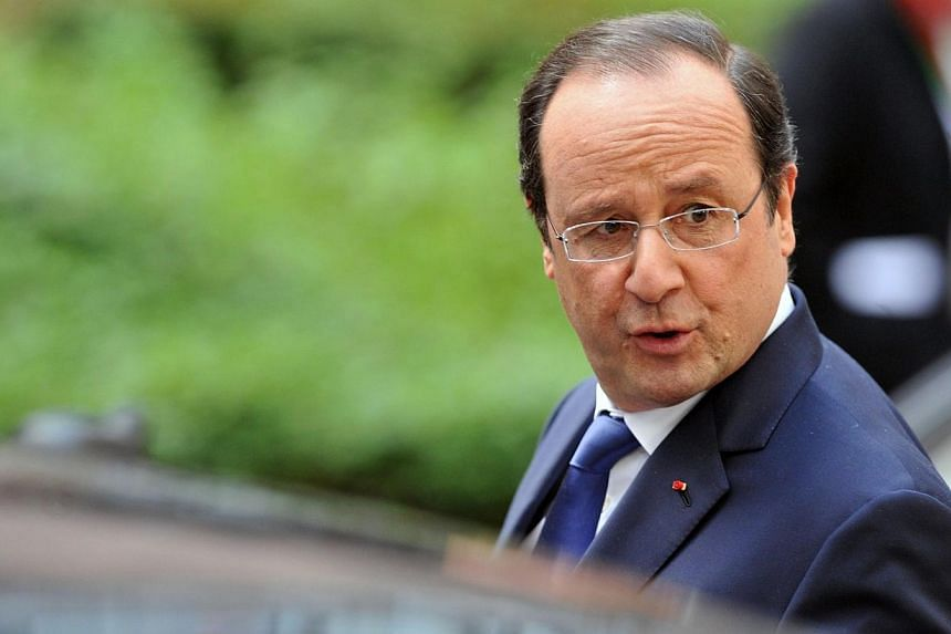 French President Francois Hollande leaves the EU headquarters in Brussels on March 21, 2014 at the end of the two-day European Council summit. Voting got underway in France on Sunday in the first round of mid-term local elections that could hit the r