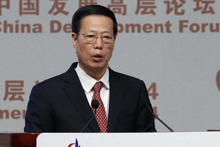 Chinese Vice-Premier Zhang Gaoli makes a speech during China Development Forum in Beijing March 23, 2014. Mr Zhang reaffirmed to a group of visiting senior foreign executives and officials on Sunday, March 23, 2014, that the country will introduce ma